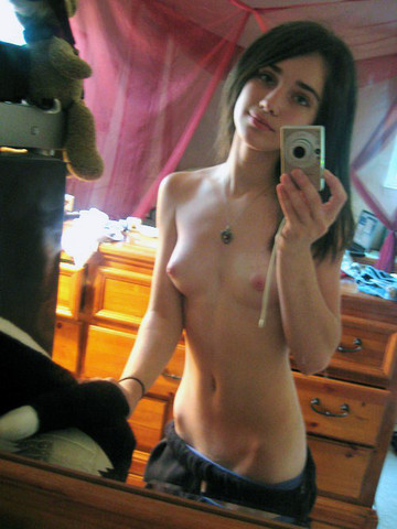 topless dark haired small breast selfie
