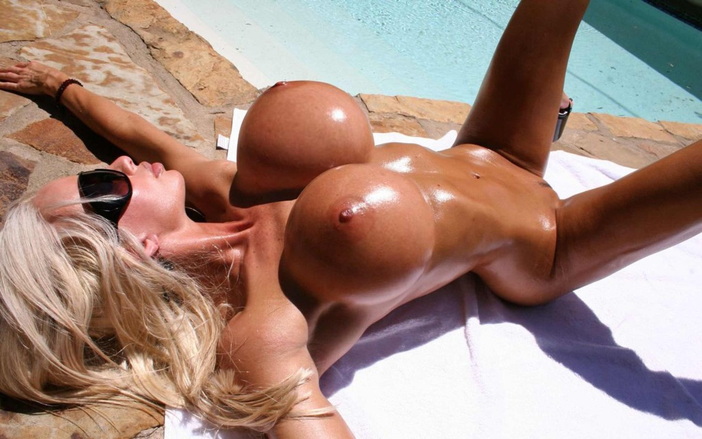 Huge fake boobs skinny blonde tanned and tanning out side by pool