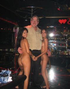 man with asian hookers