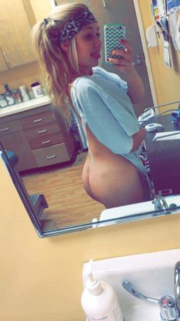 bare ass pony tail blue shirt selfie in doctors waiting room